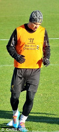 Training day: Suarez gears up for the derby at Liverpool's complex at Melwood on Friday