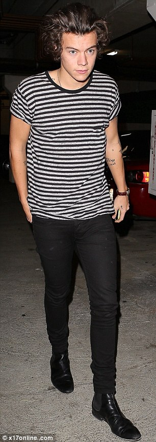 Cool as always: Harry stepped out in a cool T-shirt and pair of trousers for his lonesome dinner