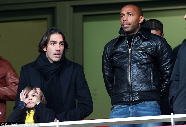 Famous faces: Former Gunners Robert Pires (left) and Thierry Henry were in the stands at the Emirates