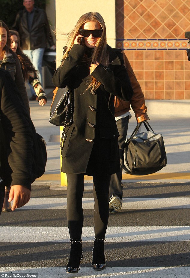 Wintry wear: Carmen Electra opted for a woolen coat and warming leggings as she jetted home to Los Angeles from Las Vegas on Friday