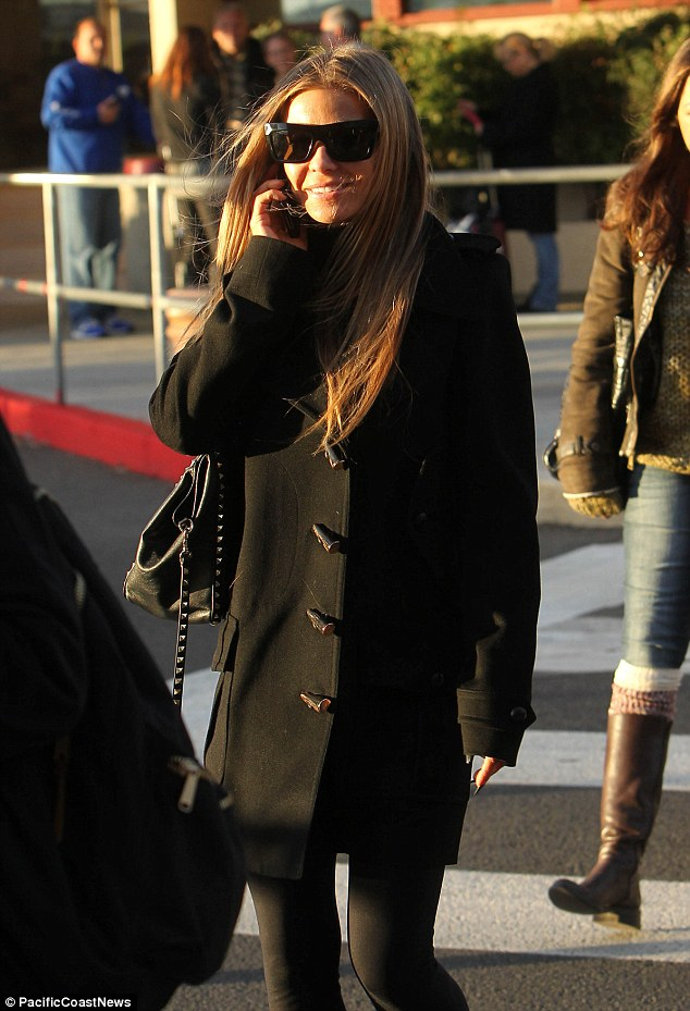 Windy city: The 41-year-old star smiled and chatted on her cell phone as the chilly wind whipped her hair about