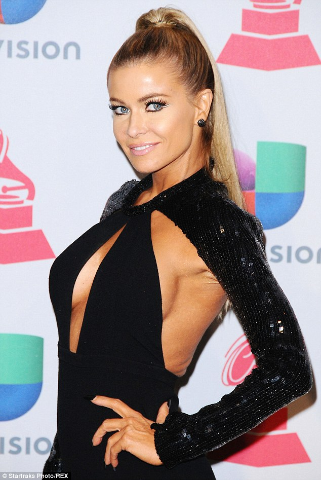 Daring: The former Pussycat Dolls star wowed all in her racy cut-out gown at the Latin Grammys in Las Vegas on Thursday