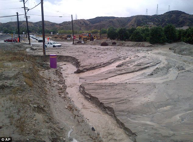 Chaos: Flooding, mud and debris in Redlands, California, caused dozens of calls to firefighters of weather-related traffic collisions, flooding and mudslides spurred by Thursday's downpour. More is coming this weekend