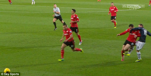 No way past: Wayne Rooney (right) hacks down Cardiff's Jordon Mutch from behind