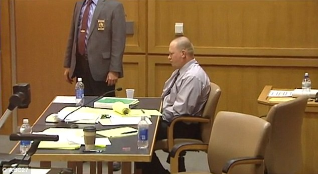 No master plan: Mr Chritten is alone with his thoughts as he hangs his head in court