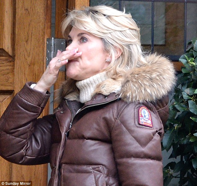 Teary: Anthea Turner was spotted holding back the tears as she moves out of the £5million marital home she shared with Grant Bovey.