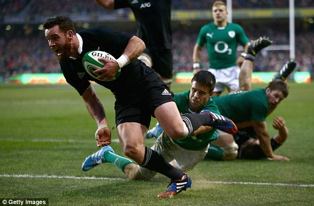 Heartbreaker: New Zealand replacement Ryan Crotty crosses for the winning try against Ireland in Dublin
