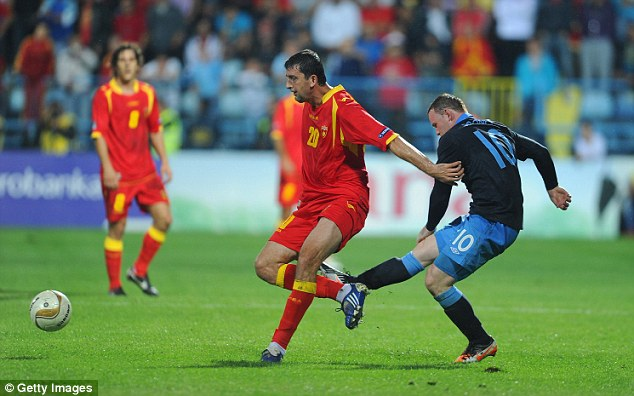 Previous: Rooney kicks Miodrag Dzudovic of Montenegro during a qualifier with England