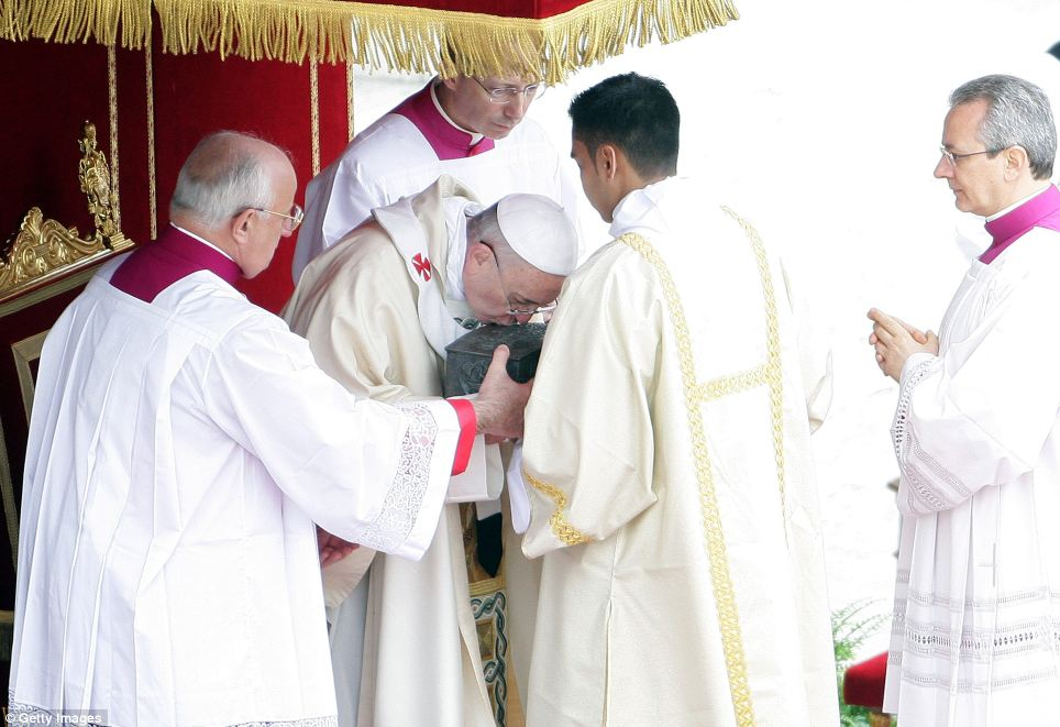 Holy: Pope Francis kisses relics of St. Peter the apostle - which he held in his arms for several minutes