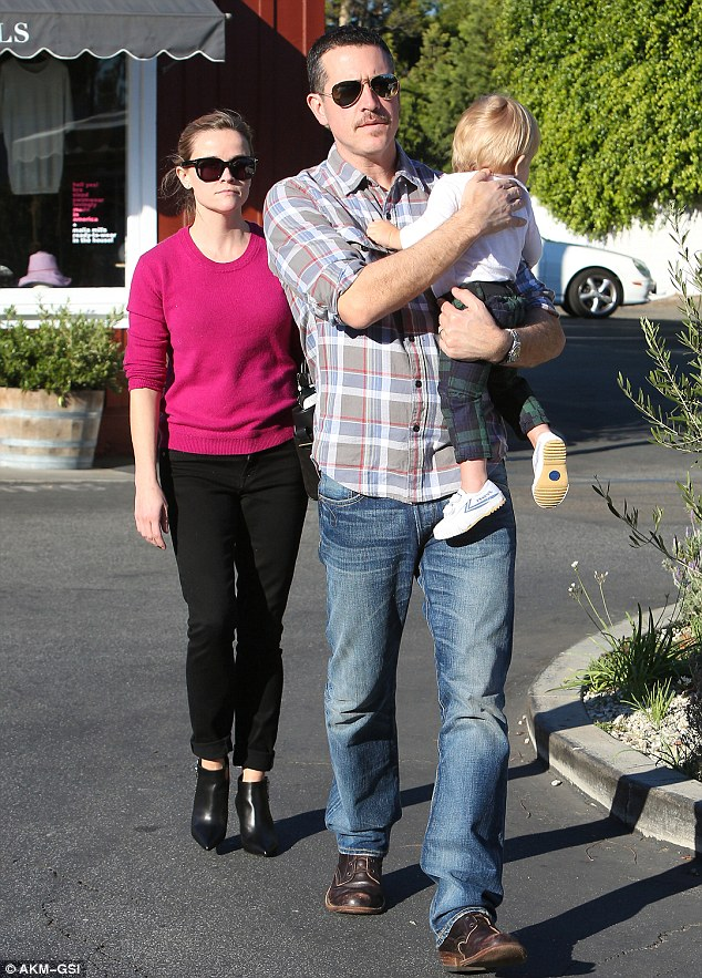 Dwarfed: At six-foot-one, the 43-year-old CAA agent is literally a foot taller than his famous wife of two years