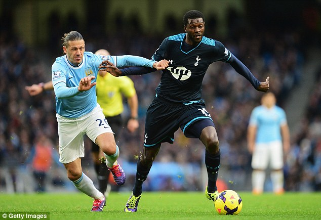 Sub way: Adebayor came on to play against his former club during Tottenham's 6-0 mauling at the Etihad