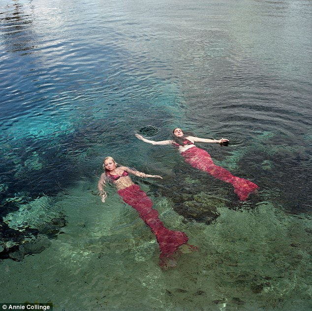Relaxing dip: Two mermaids take a little swim in their red tails