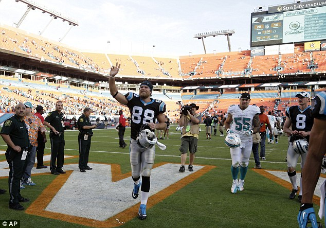 Victory: Olsen walks off the field at Sun Life Stadium after helping Carolina to a win