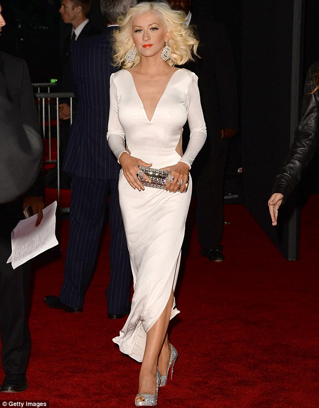 Show them how it's done: Christina owned the red carpet in her silver, open-toed heels