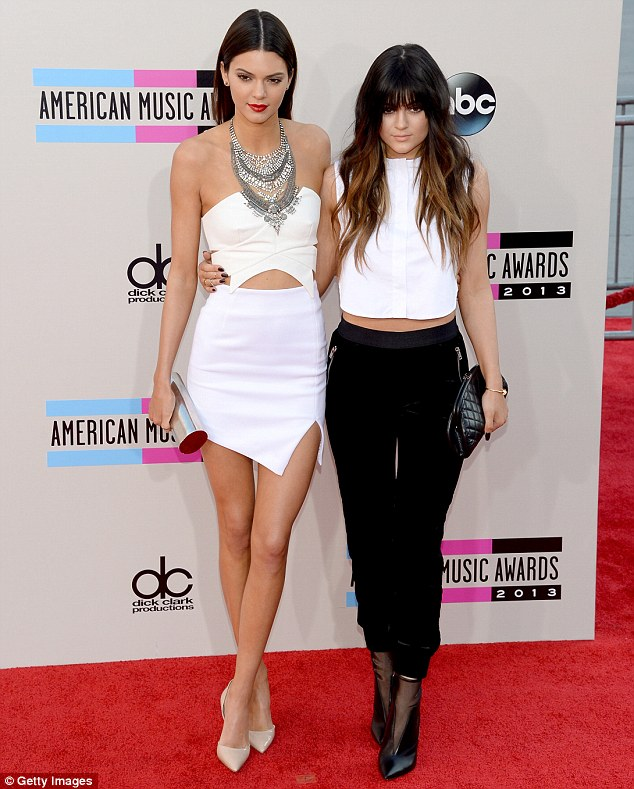 Sisters in arms: Kendall and Kylie cuddled up together for a photo as they arrived at the ceremony
