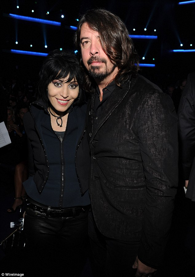Love Is All Around: The impossibly youthful Joan cosied up to Foo Fighters frontman Dave Grohl