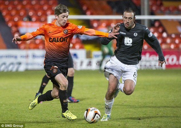 Arms length: Ryan Gauld (left) tries to get beyond Partick's Stuart Bannigan during the 4-1 win on Saturday