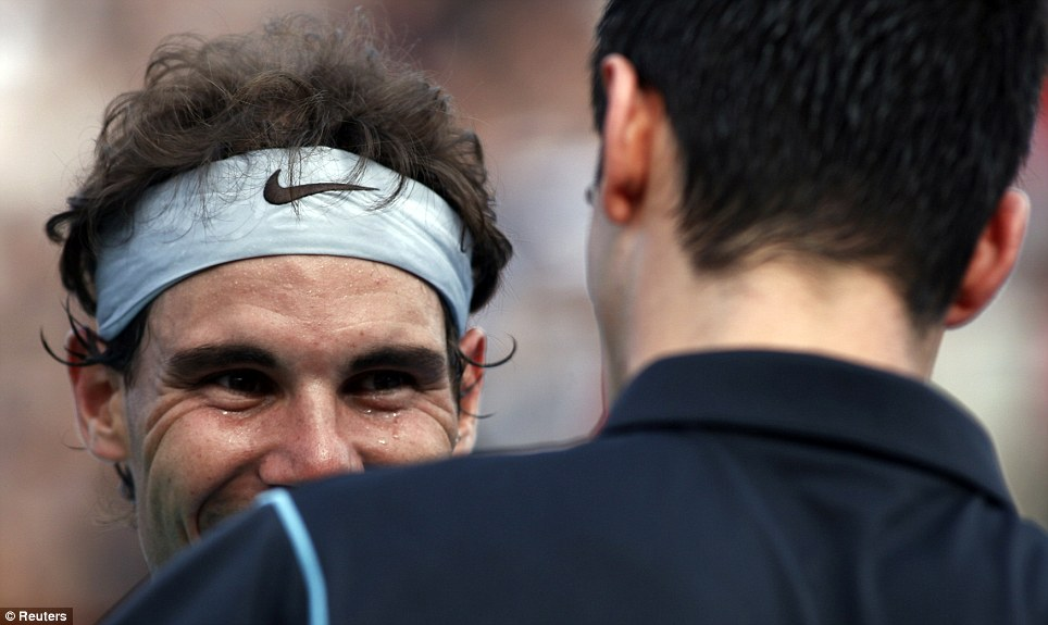 World No 1 tennis player Rafael Nadal of Spain looks at Serbia's Novak Djokovic during their exhibition tennis match in Buenos Aires. Nadal won 6-4, 7-5