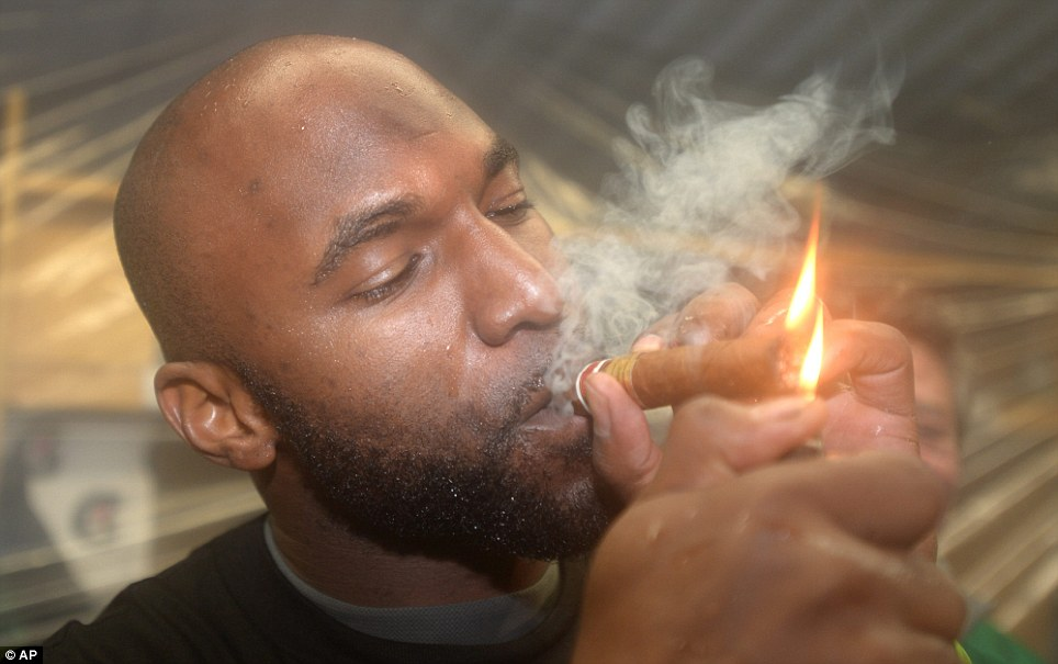 Saskatchewan Roughriders quarterback Darian Durant celebrates by lighting up a cigar after beating the Hamilton Tiger-Cats in the Grey Cup