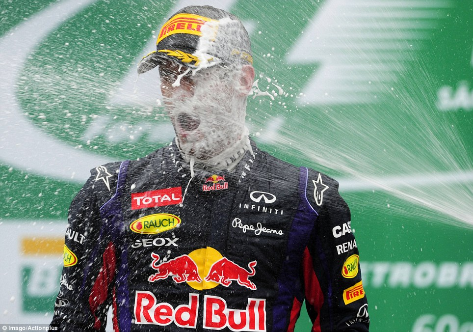 Australian Formula One driver Mark Webber is sprayed with champagne after finishing in second place in the Brazilian Grand Prix in Sao Paulo, his last ever race