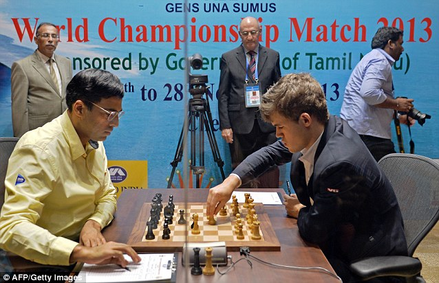 Anand (L) and Magnus compete in their 10th championship chess match in which Magnus needed just a draw to take the world champion crown and complete his ascent to the top of the game