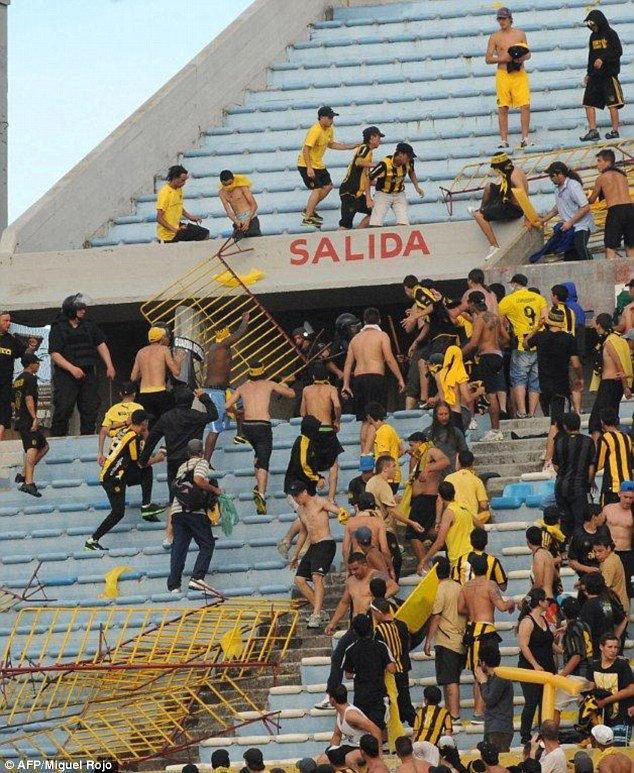 Riot: Penarol vice president Edgard Welker said fans were incensed by a Nacional supporters' banner