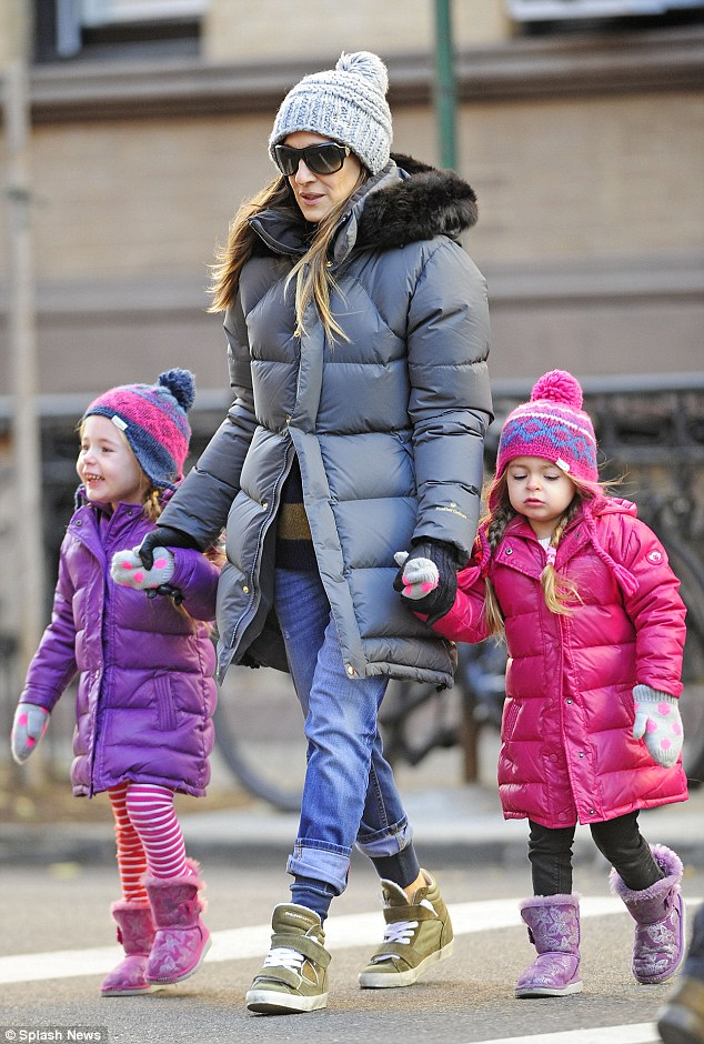 Time for school: Sarah Jessica Parker walks twins Marion and Tabitha Broderick in the freezing cold on the way  to school in the West Village in New York City on Monday