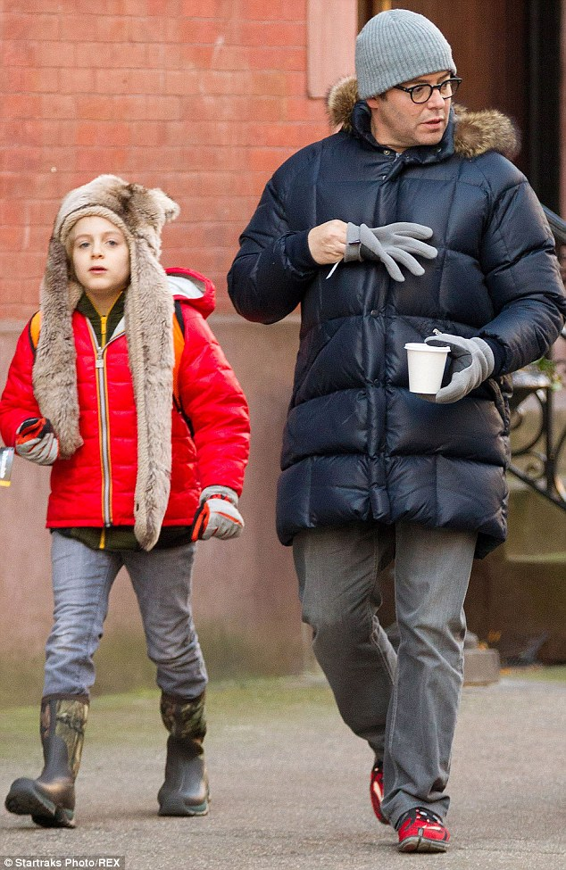 Walking along: Sarah's son James and husband Matthew Broderick walked nearby and also dressed for the winter weather