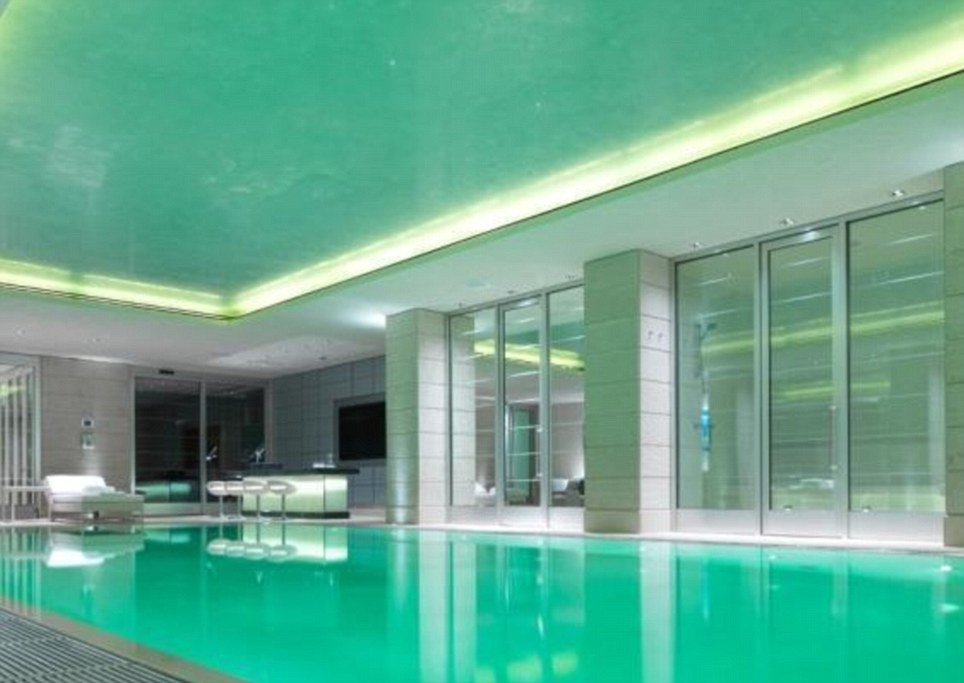 Living it up: Why not take a dip in this posh pool in one of London's most expensive properties which is on the market for £37.5million