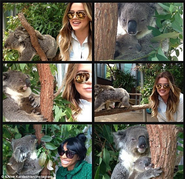 Put on a happy face: During her trip to Sydney with best pal Malika Haqq, Khloe was in much better spirits