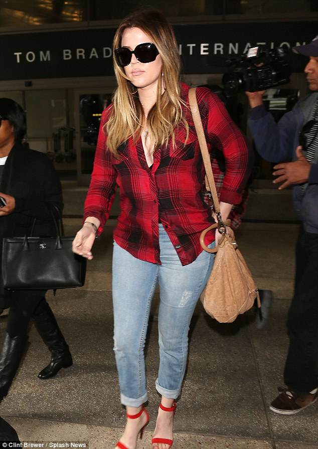Face of thunder: Khloe's had a face of thunder since arriving home to California from Sydney, Australia on Saturday