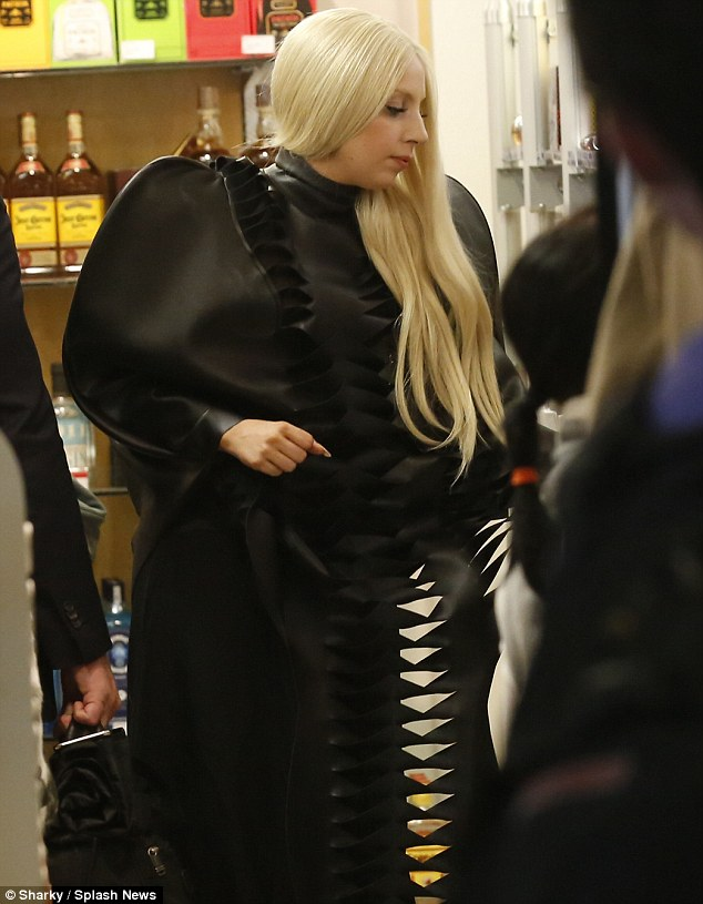 Is this my new signature scent? Lady Gaga is dressed in all black as she tests some perfume in Los Angeles