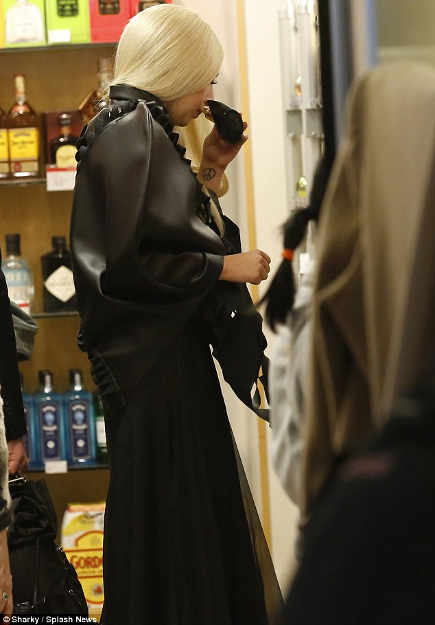 How about this one? The Lady tries out different perfumes in the duty-free shop