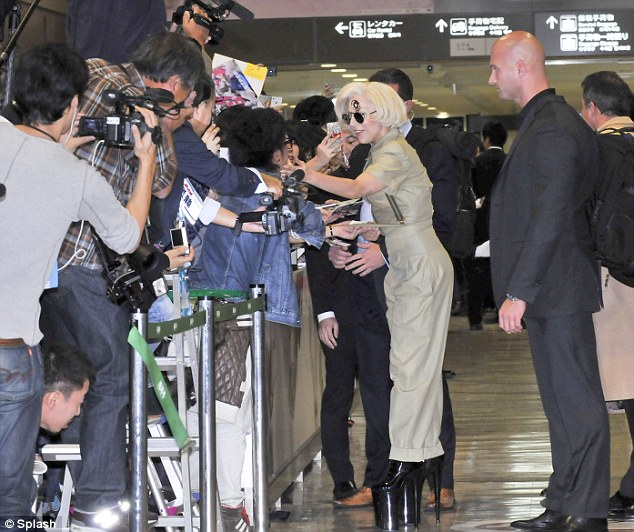 Meet and greet: Gaga took the time to sign autographs for some of her eagerly awaiting fans - many of whom had waited for hours in a bid to catch a glimpse of their idol