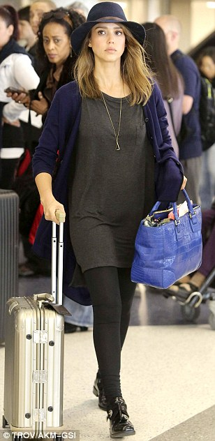 Touches of blue: Jessica added colour to her simple outfit with a blue hat, sweater and purse