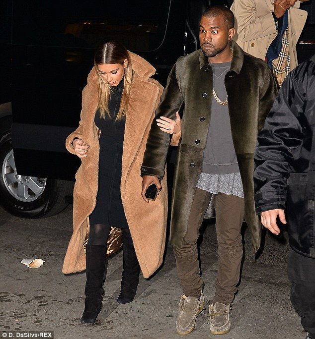 Cosy coats: The superstar couple have been sporting coordinated furry coats throughout their current stint in the Big Apple