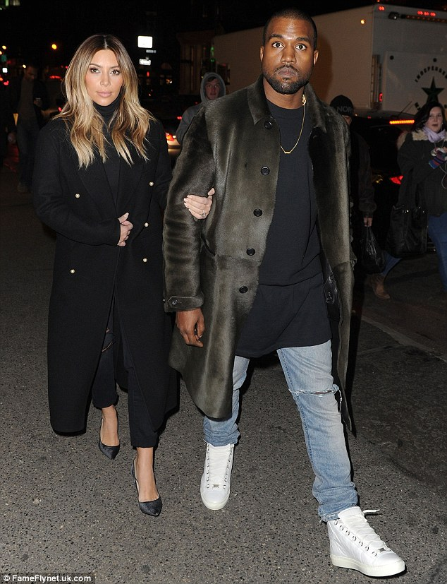 Stepping out in style: Ensuring his look was in line with his fiancee's, Kanye also opted for black, teaming a simple dark sweater with his favourite full length black fur coat