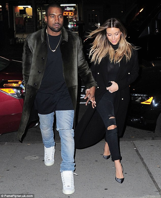Sartorial snap: Kim Kardashian and Kanye West made sure to continue their matching winter wardrobe parade as they stepped out in New York City on Monday
