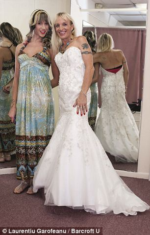 Jessica Lynn Cummings, 39 posing for a picture with her transgender friend Tressa while shopping for wedding dress in Wilton Manors, Florida