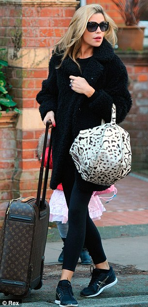 What have you got in there? Abbey and her dance partner Aljaz Skorjanec were earlier seen toting suitcases to rehearsals
