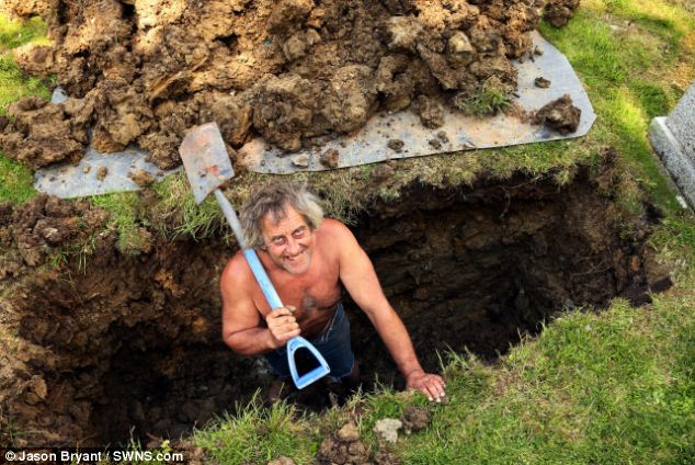 In too deep: Mr Loxton, who was digging the grave for his friend, said that no offense was intended by the picture and that he was simply stopping the bright sun from blinding him