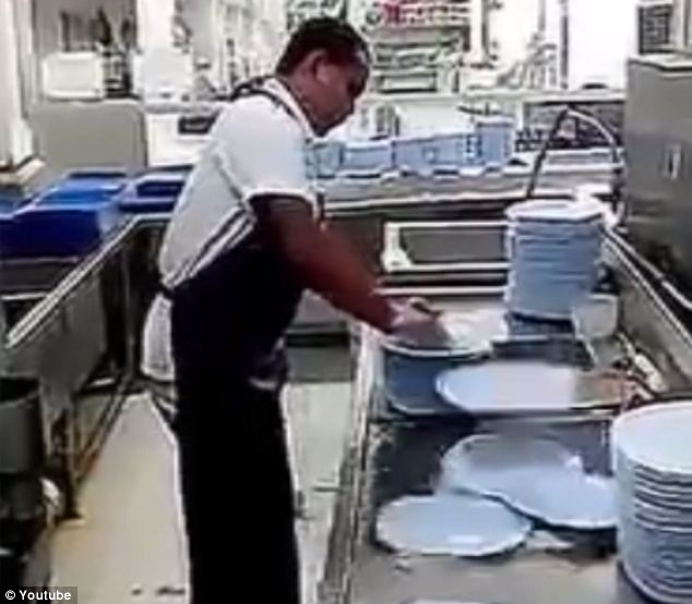 Thorough? Many YouTube users questioned whether the man could possibly have got the plates clean