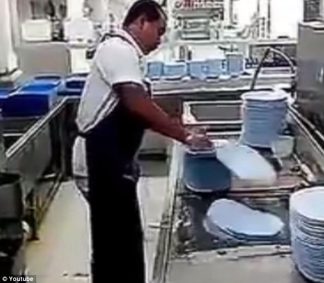 Too many plates, too little time: He whisks through the pile, sending plates flying which remain intact