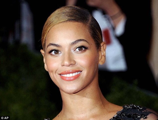 Sleek: The key to this look is plenty of hydration, Beyonce works the trend to perfection