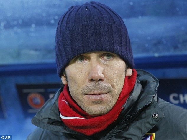 Wrapped up: Atletico manager Diego Simeone rested a number of first-team players for the clash in Russia