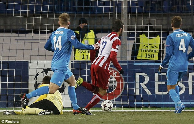 Ahead: Adrian Lopez wheels away to celebrate after sliding the ball under Zenit goalkeeper Yuri Lodygin