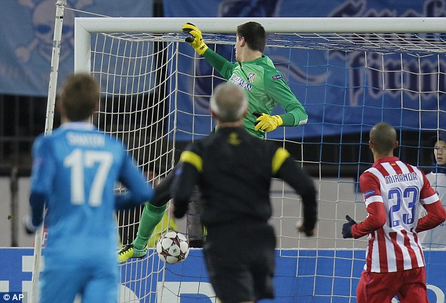 Powerless: Atletico Madrid keeper Thibaut Courtois watches Toby Alderweireld's deflection sail in to the net