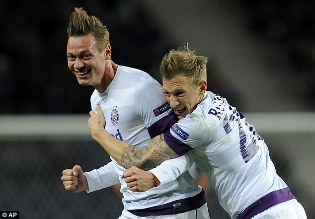Ecstatic: Roman Kienast (left) celebrates with Vienna's Daniel Royer after scoring Vienna's first group goal