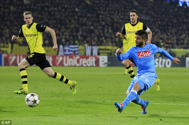 Hope: Frontman Lorenzo Insigne fires home but the goal wasn't enough to see Napoli get back into the game