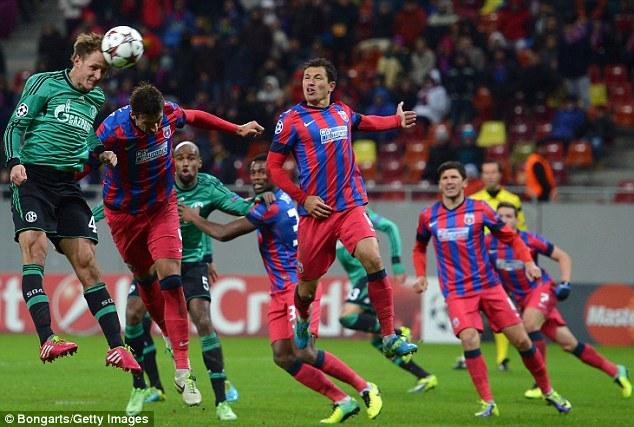 Stalemate: Schalke defender Benedikt Howedes can only head the ball over from a corner kick